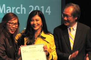 Director-producers Shirley Yung (left) and Carrie Ng collect the HAF Award from Create Hong Kong's Jerry Liu
