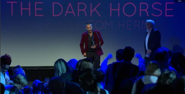 Tom Hern accepts the Best Film award for the Dark Horse