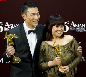 Eugene Domingo celebrates her 2012 AFA win with Hong Kong actor Andy Lau