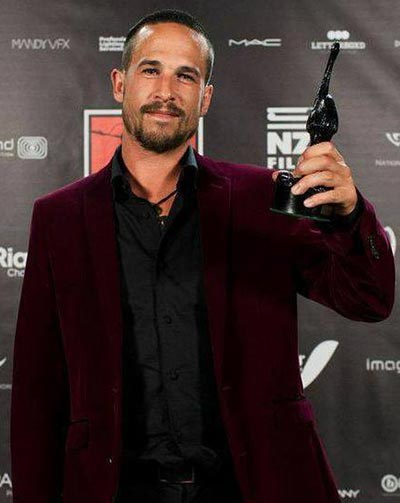 Tom Herns with a bird in the hand at the 2014 NZ Film Awards