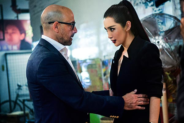 Transformers: Age of Extinction: Stanley Tucci and Li Bingbing re-enact a scene from Len Broiwn's office